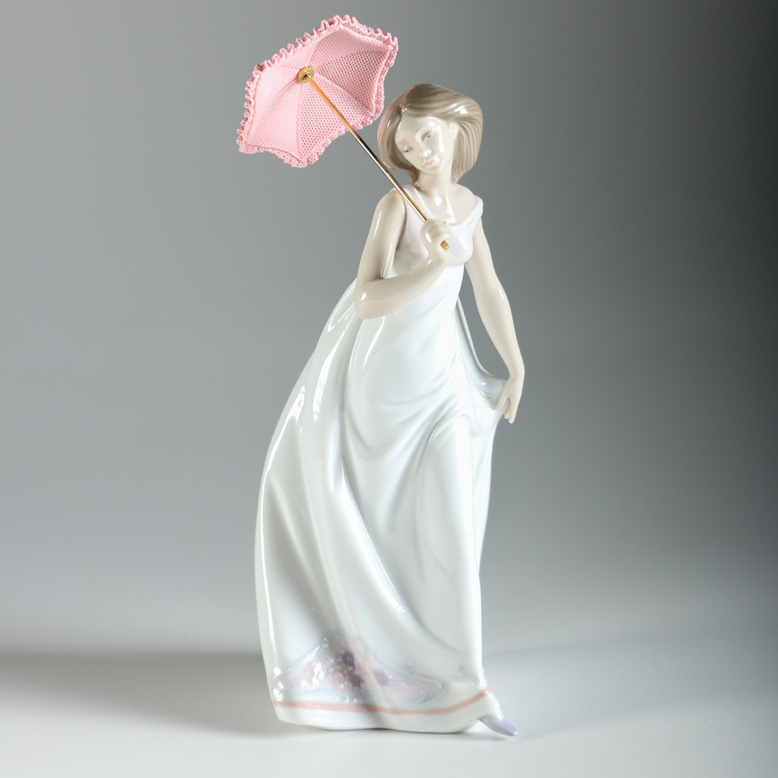 Lladro Girl With Pink Parasol Figurine Ebth