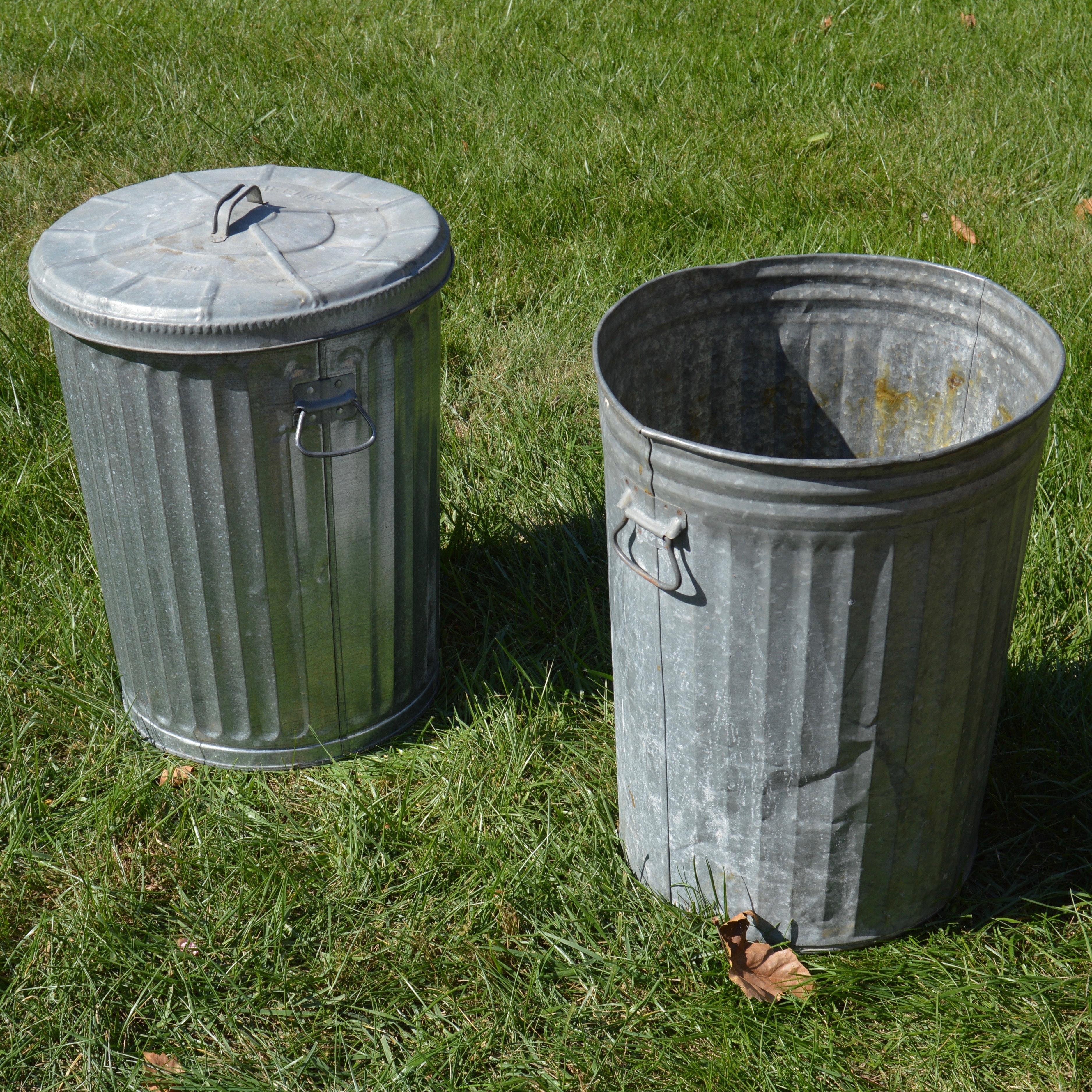 two vintage wheeling metal trash cans