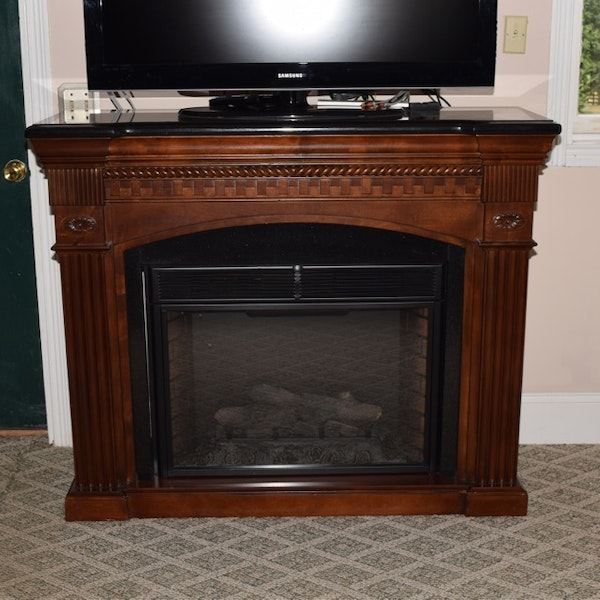 twin star faux electric fireplace in mahogany mantel with granite top