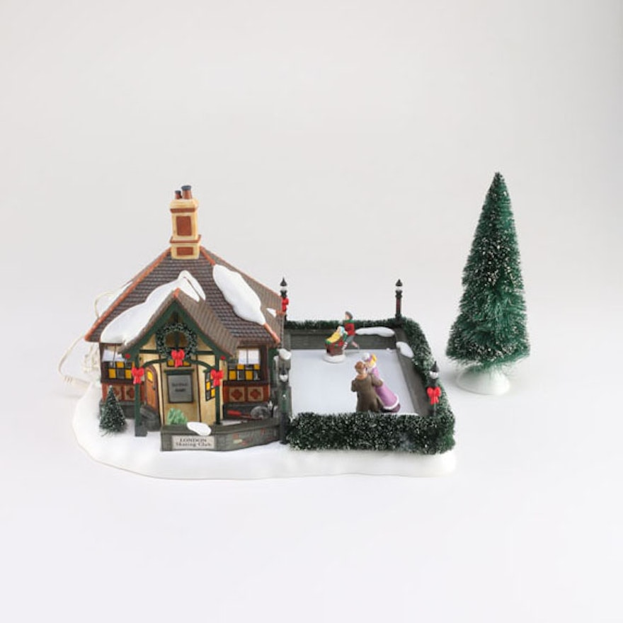 department 56 dickens 39 village series london skating club with faux tree ebth. Black Bedroom Furniture Sets. Home Design Ideas