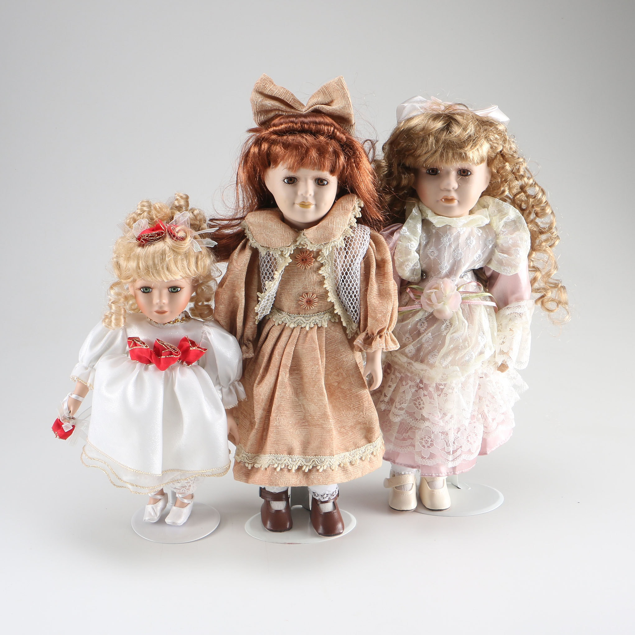 Three Marked Dolls