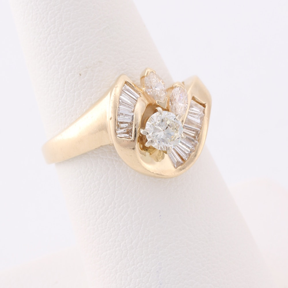 14K Gold Ring Featuring Round, Baguette and Marquise Cut Diamonds