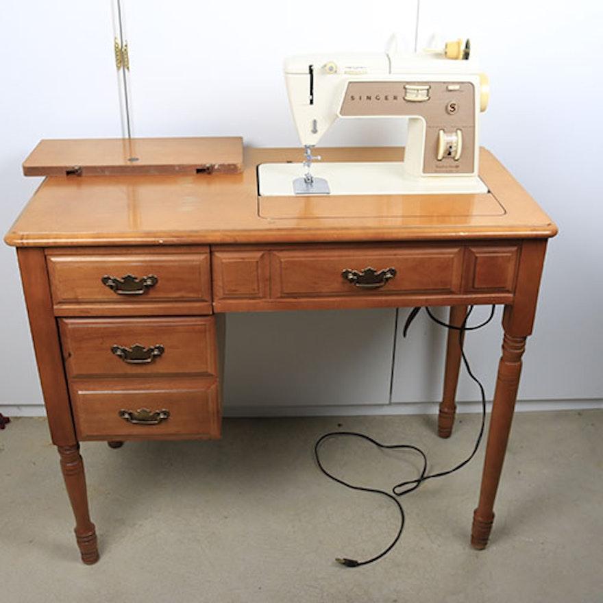 vintage singer sewing machine with maple cabinet ebth. Black Bedroom Furniture Sets. Home Design Ideas
