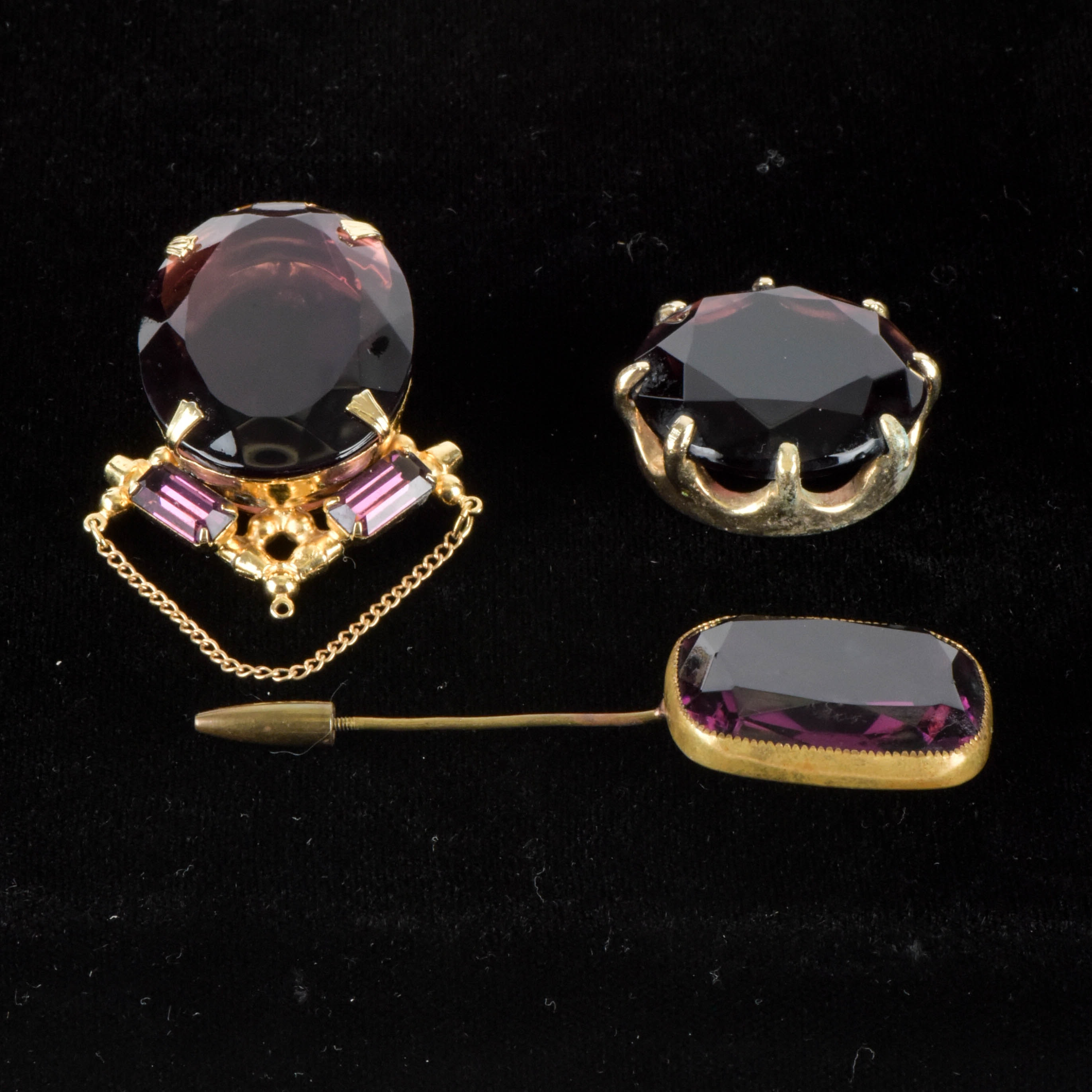 Amethyst Glass and Gold Tone Brooches and Pendant