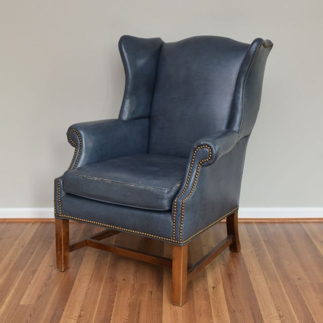 old hickory tannery leather wingback chair with brass nailhead trim