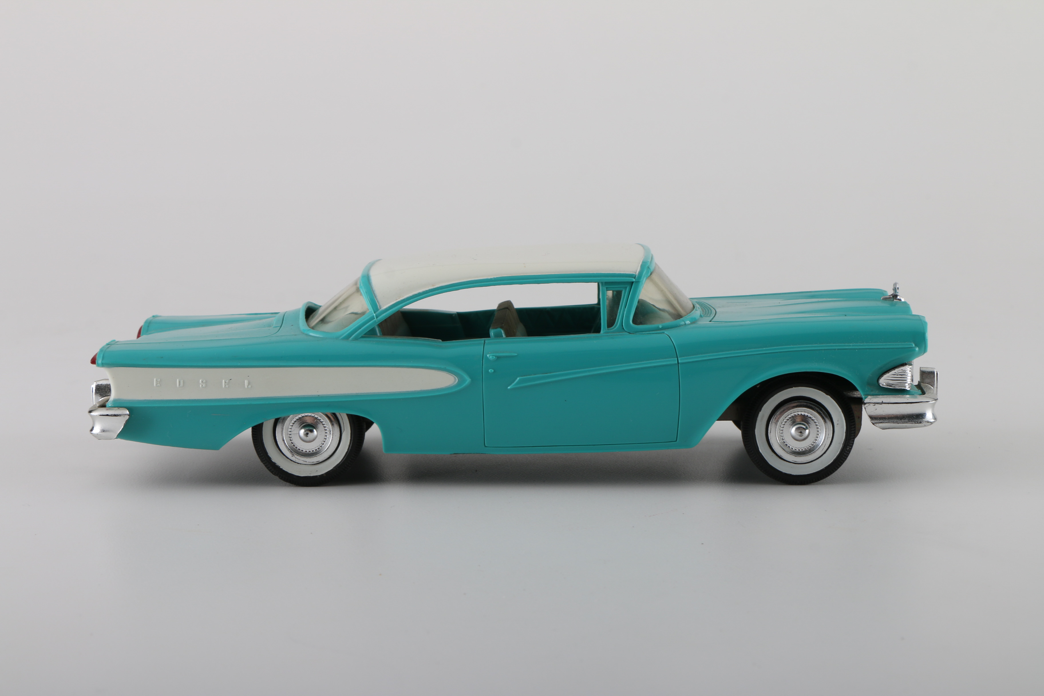 A Pair Of 1958 Edsel Friction Promo Cars