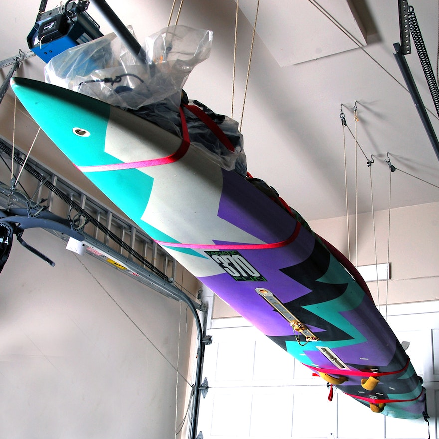 Dill Designs Windsurfing board, accessories, and life preserver