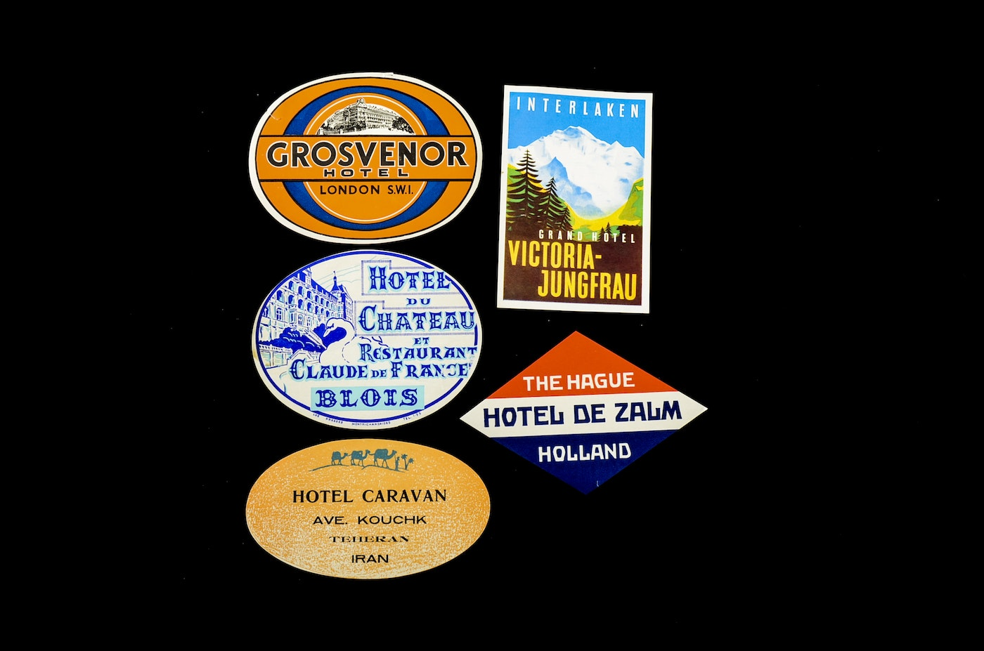 Large group of vintage hotel luggage labels from all over for Hotels all over the world
