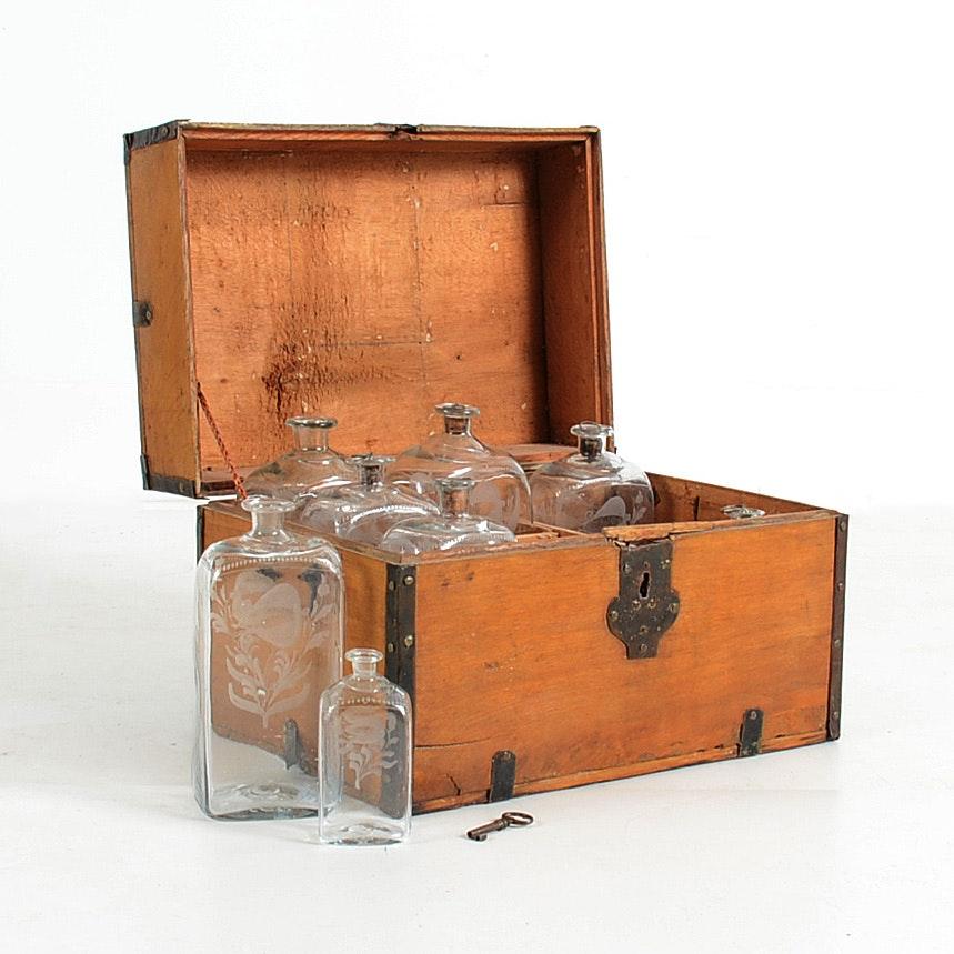 18th Century Liquor Chest with Stiegel Glass Decanter Bottles