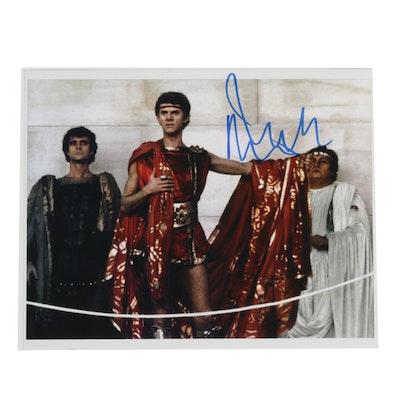 "Malcolm McDowell Signed ""Caligula"" Movie Still"