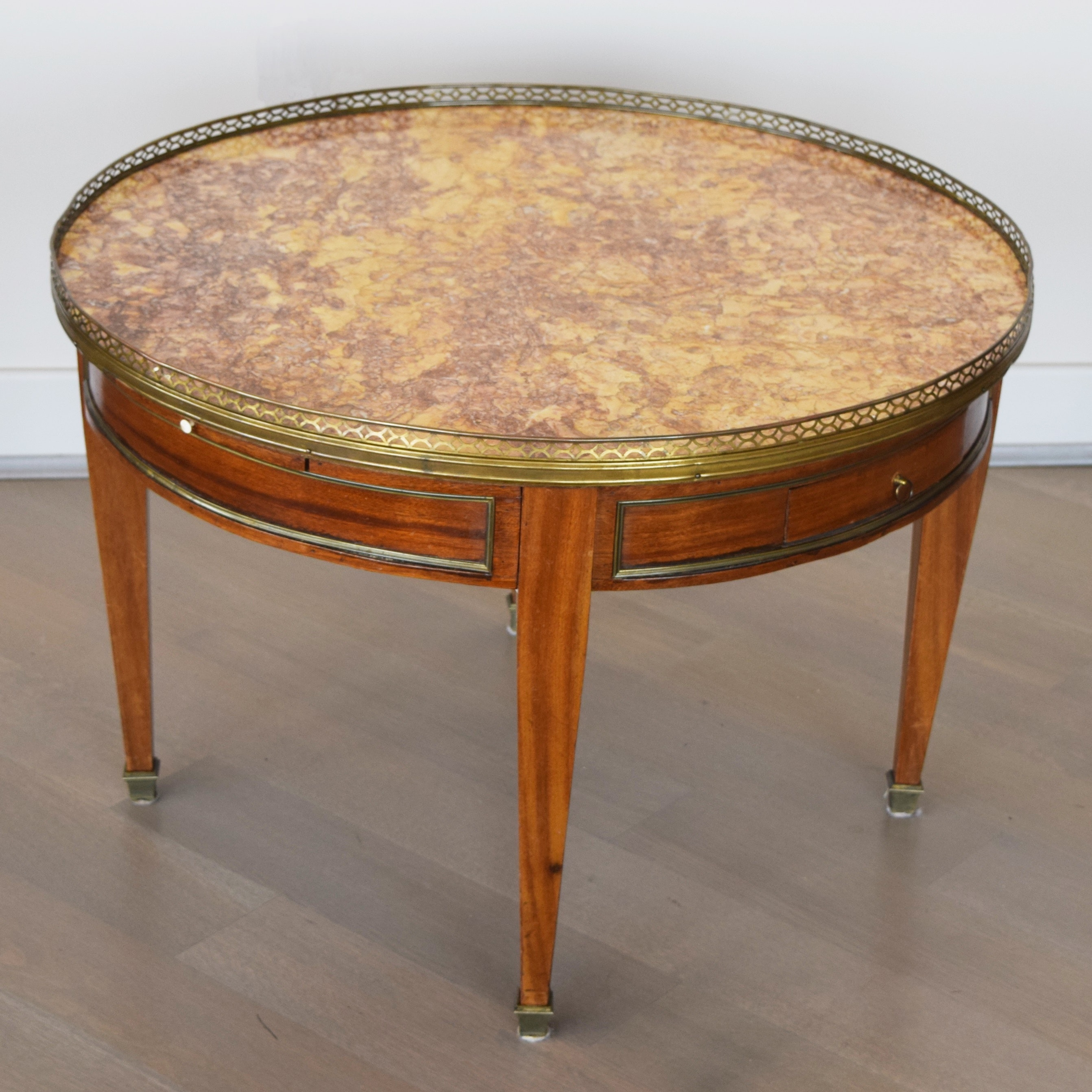 19th century round marble top coffee table with brass gallery
