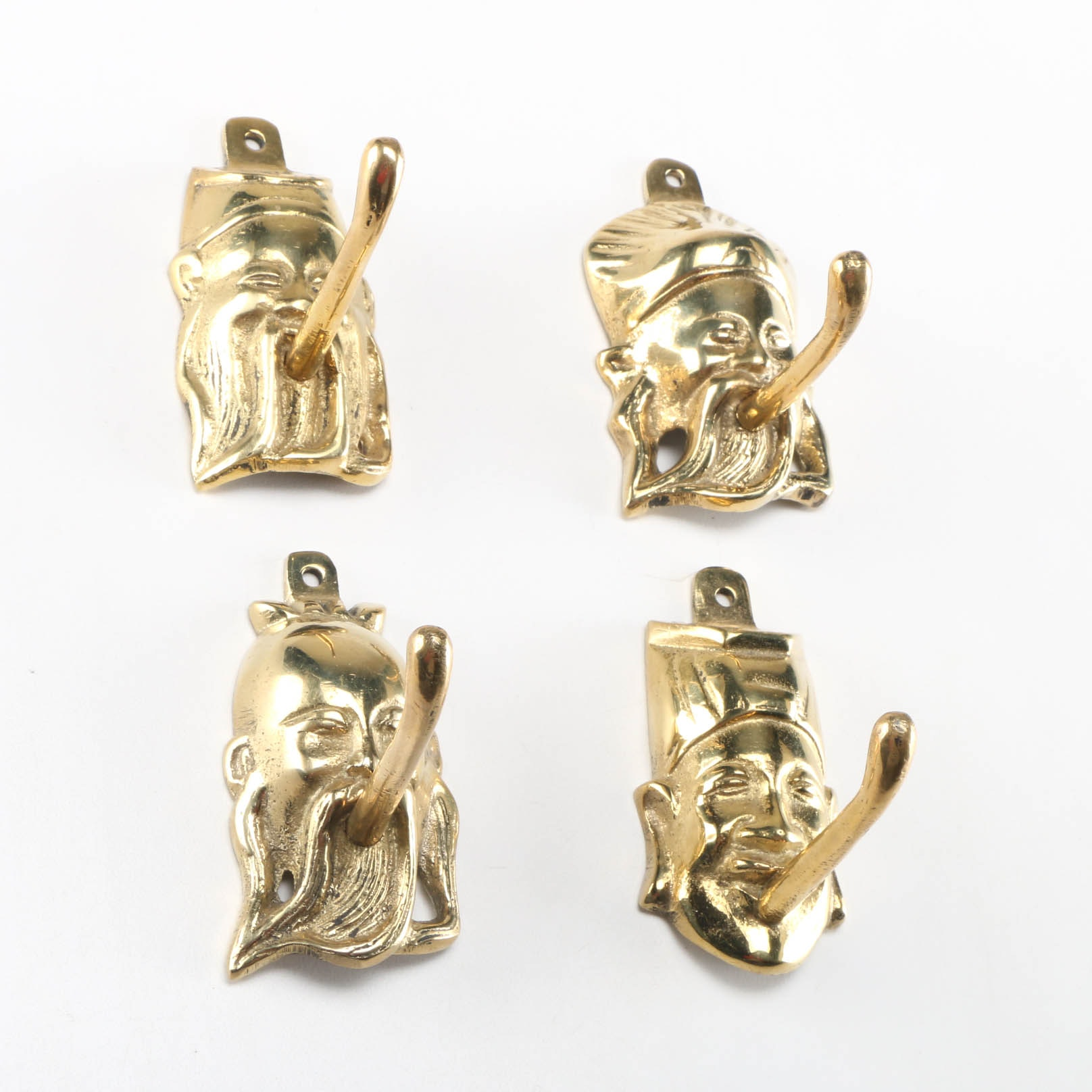 Four Figural Brass Hooks