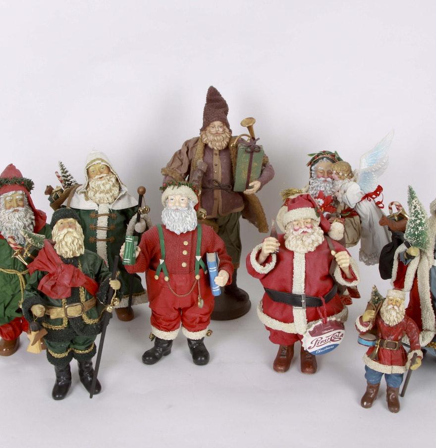 Assortment of santa claus figurines ebth