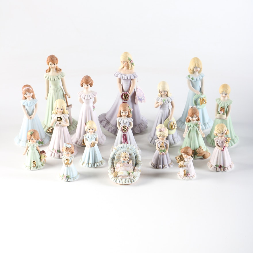 "Set of 1980s Enesco ""Growing Up Birthday Girls"" Figurines"