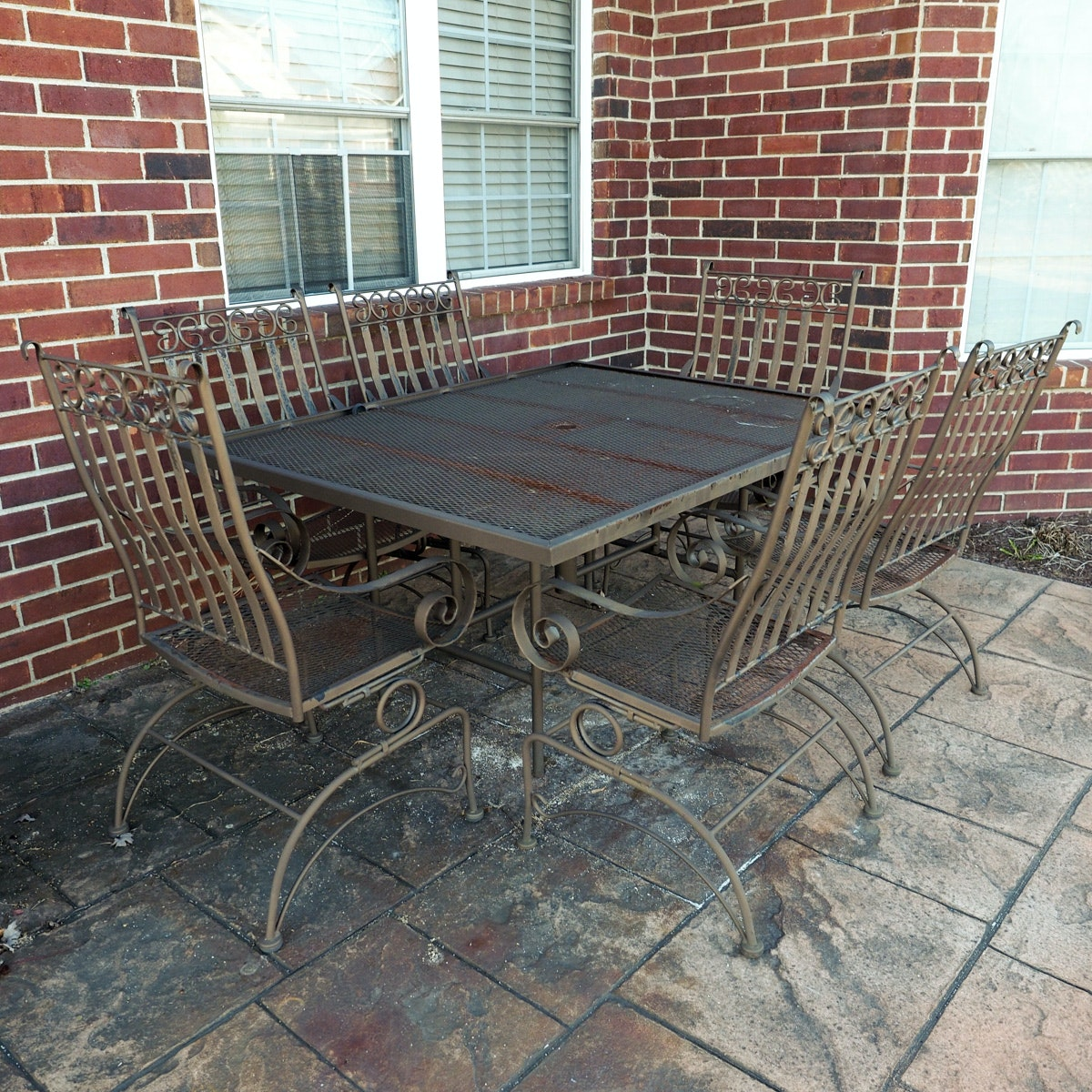 brown wrought iron patio table and chairs ebth