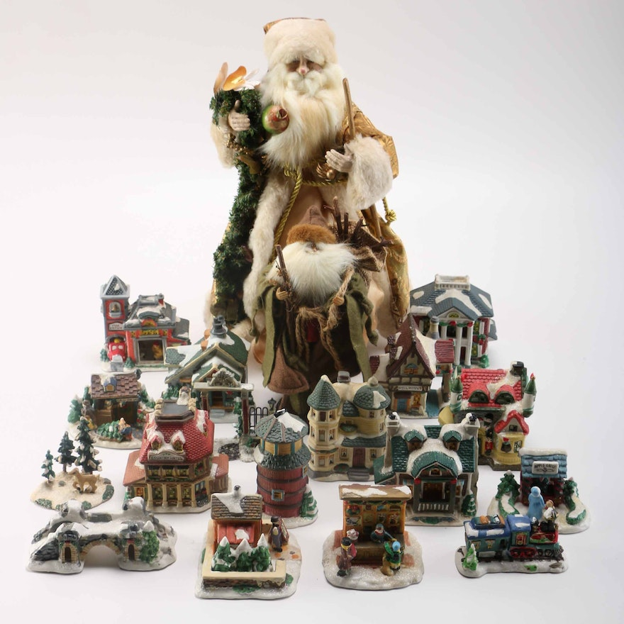 cellection of cobblestone corners porcelain christmas village items with santas