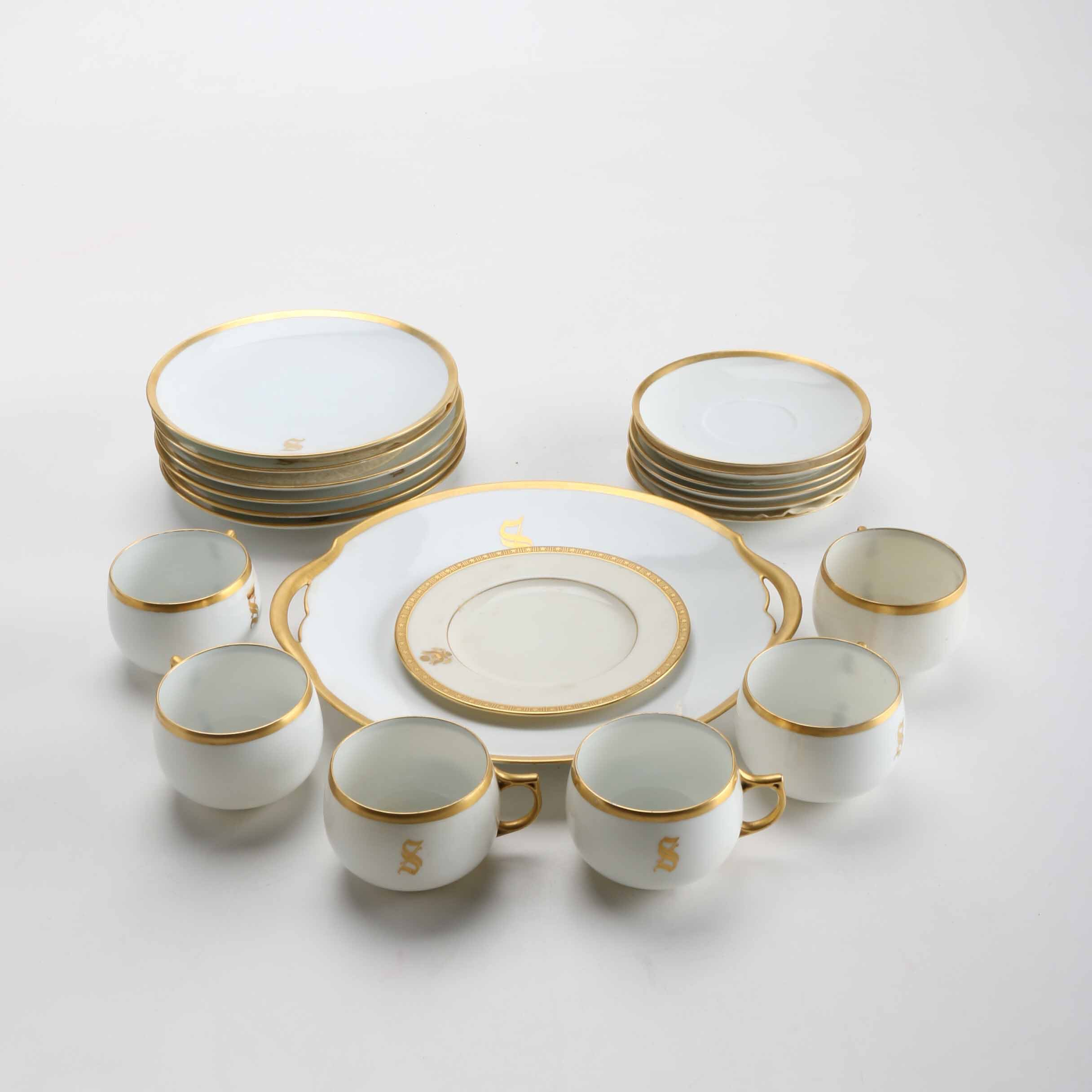 Grouping of White and Gold Tone Dinnerware