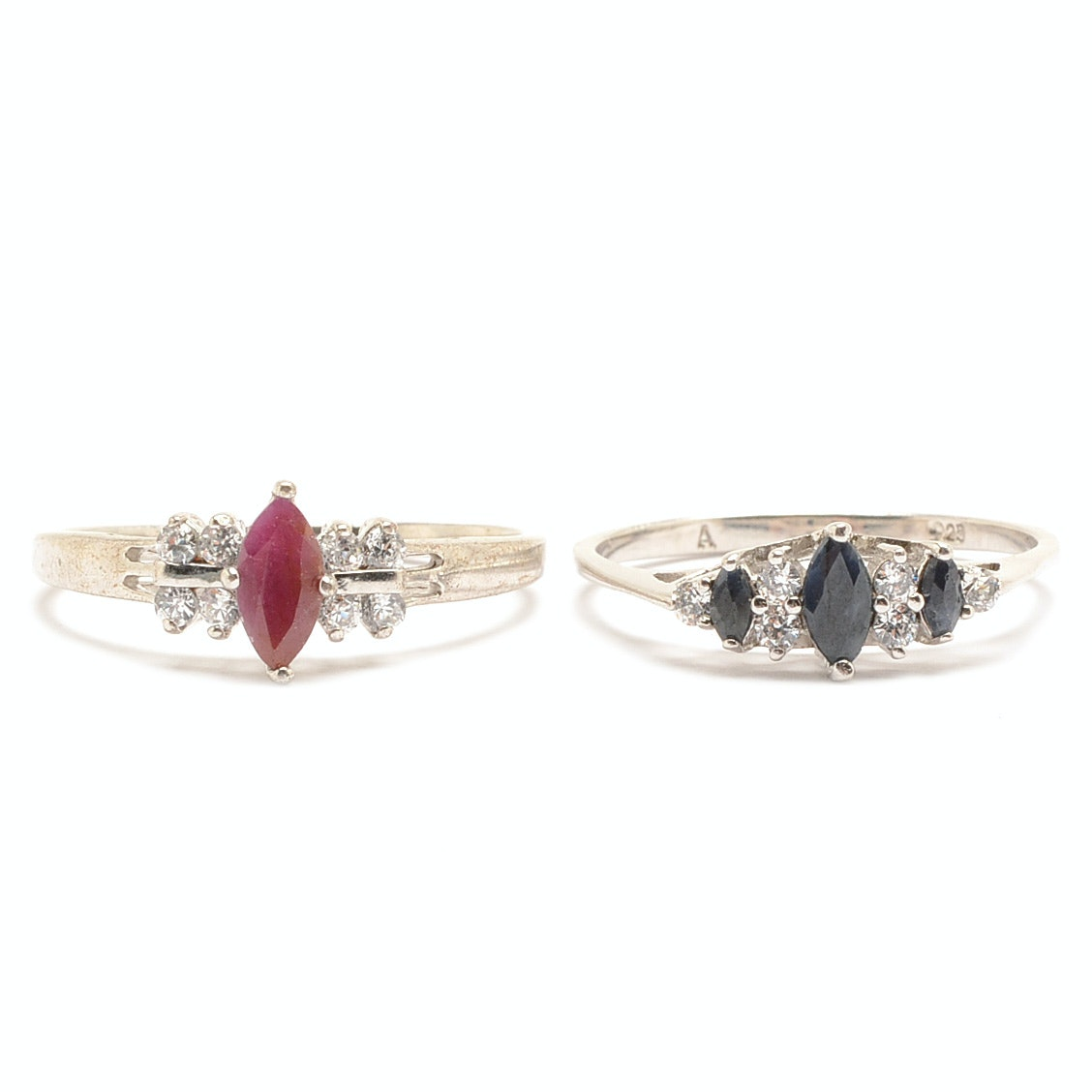 two sterling silver ruby and blue sapphire rings ebth