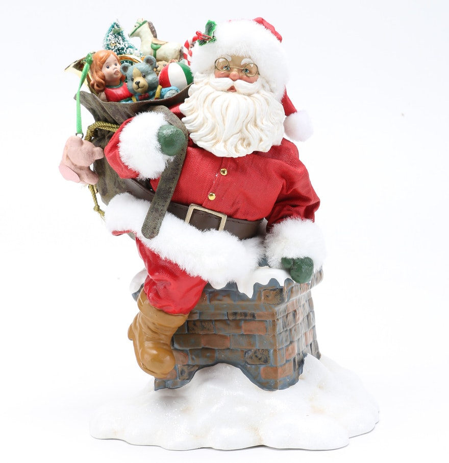 Ceramic santa claus and chimney figurine ebth