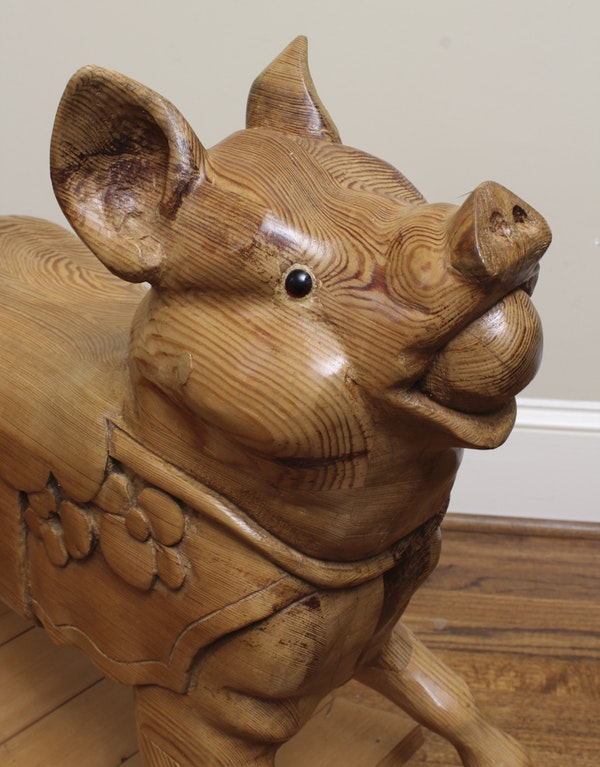 Hand carved pine wood rocking pig ebth