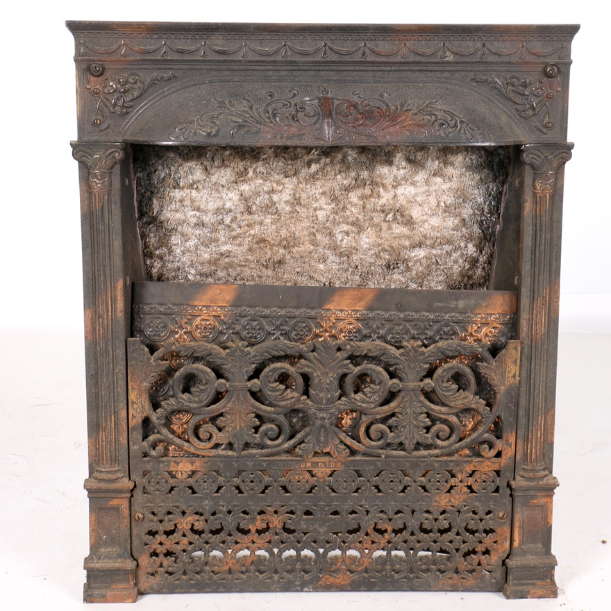 A cast iron fireplace front by Dawson Brothers of Ohio. This neoclassical late Victorian fireplace features an upper border of swags