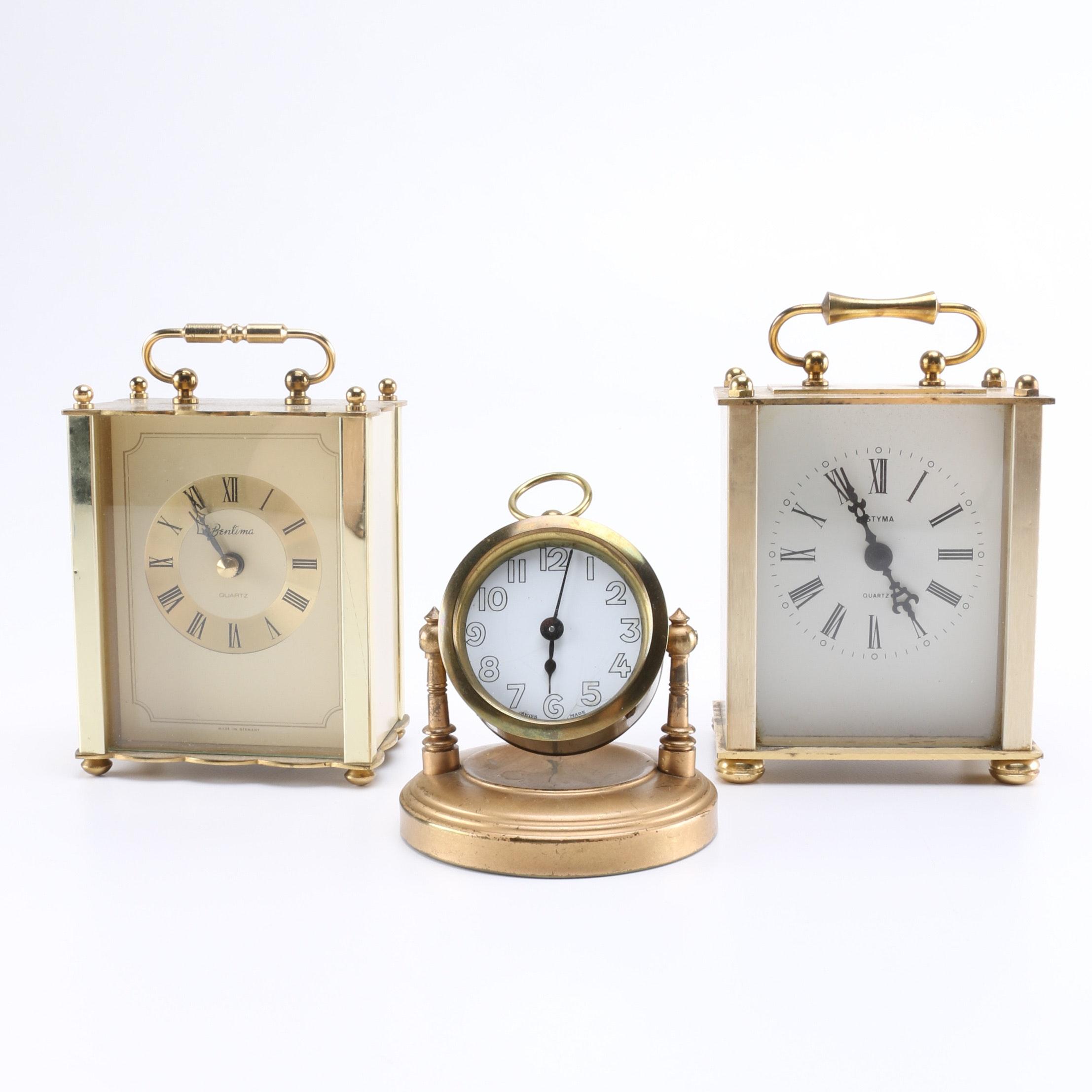 Three Brass Toned Mantel Clocks
