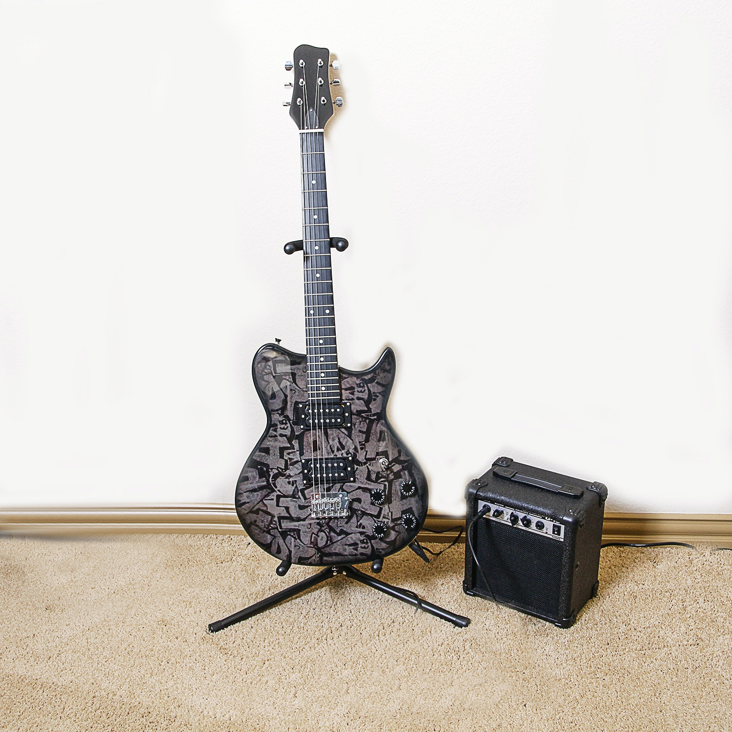 Electric Guitar With Stand and Practice Amplifier