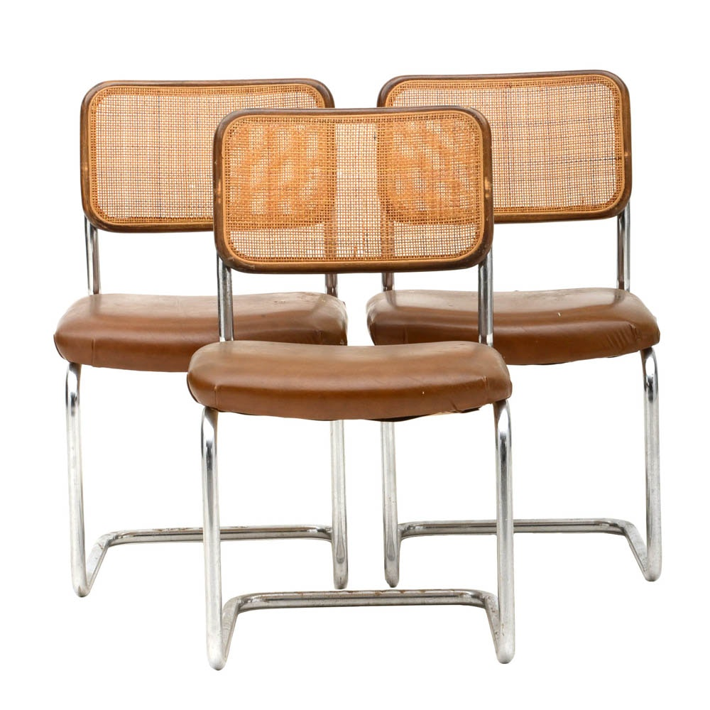 Three Cantilevered Side Chairs with Woven Cane Backs