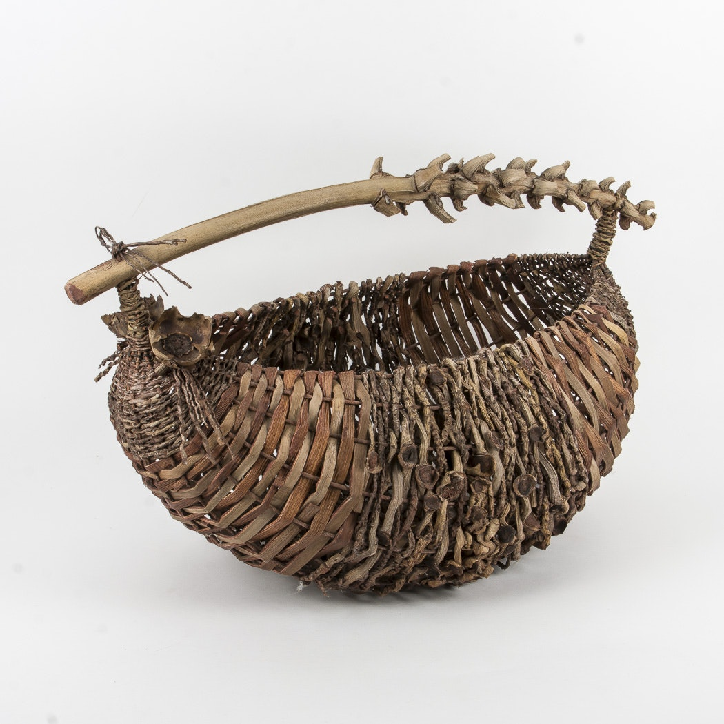 Large Woven Basket with Spiked Handle