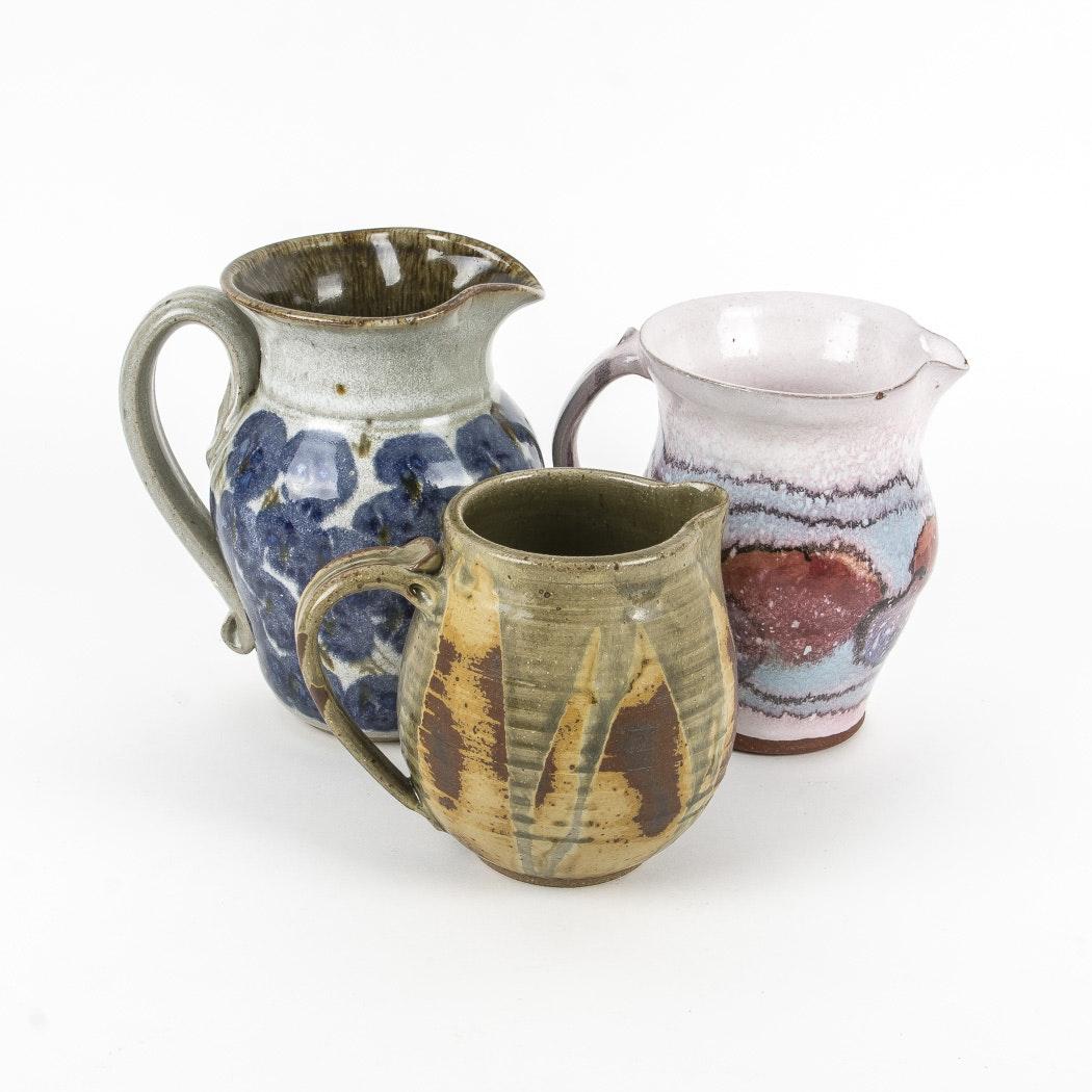 Group of Pottery Pitchers