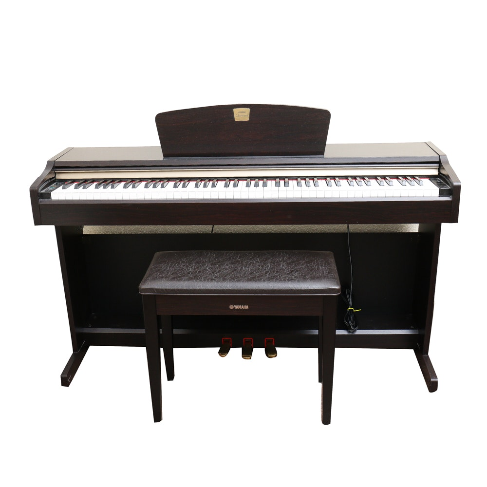 Yamaha Acoustic/Digital Piano With Headphones and Sheet Music