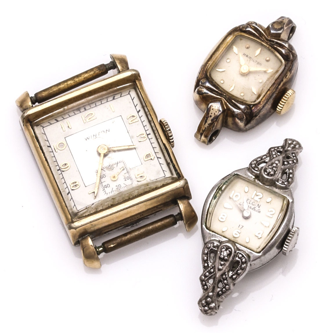 Three Women's Wristwatches and Wristwatch Cases
