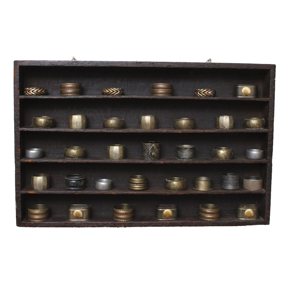 Collection of Napkin Rings and Wall Shelf