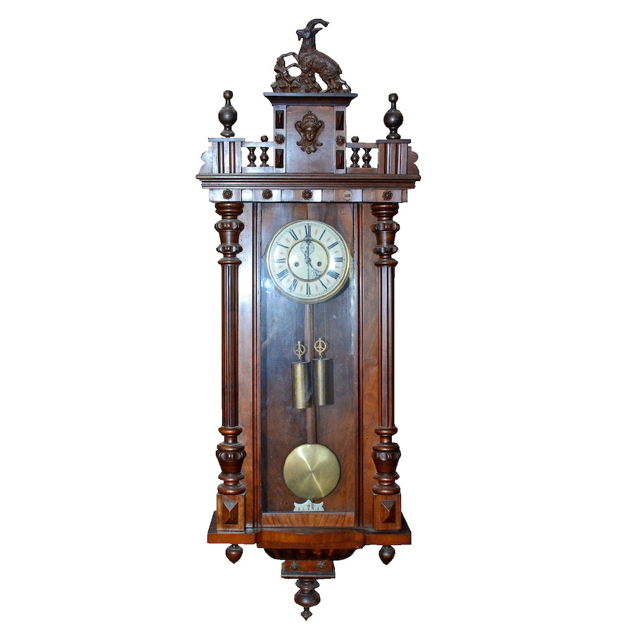 Ornately carved wooden wall clock ebth