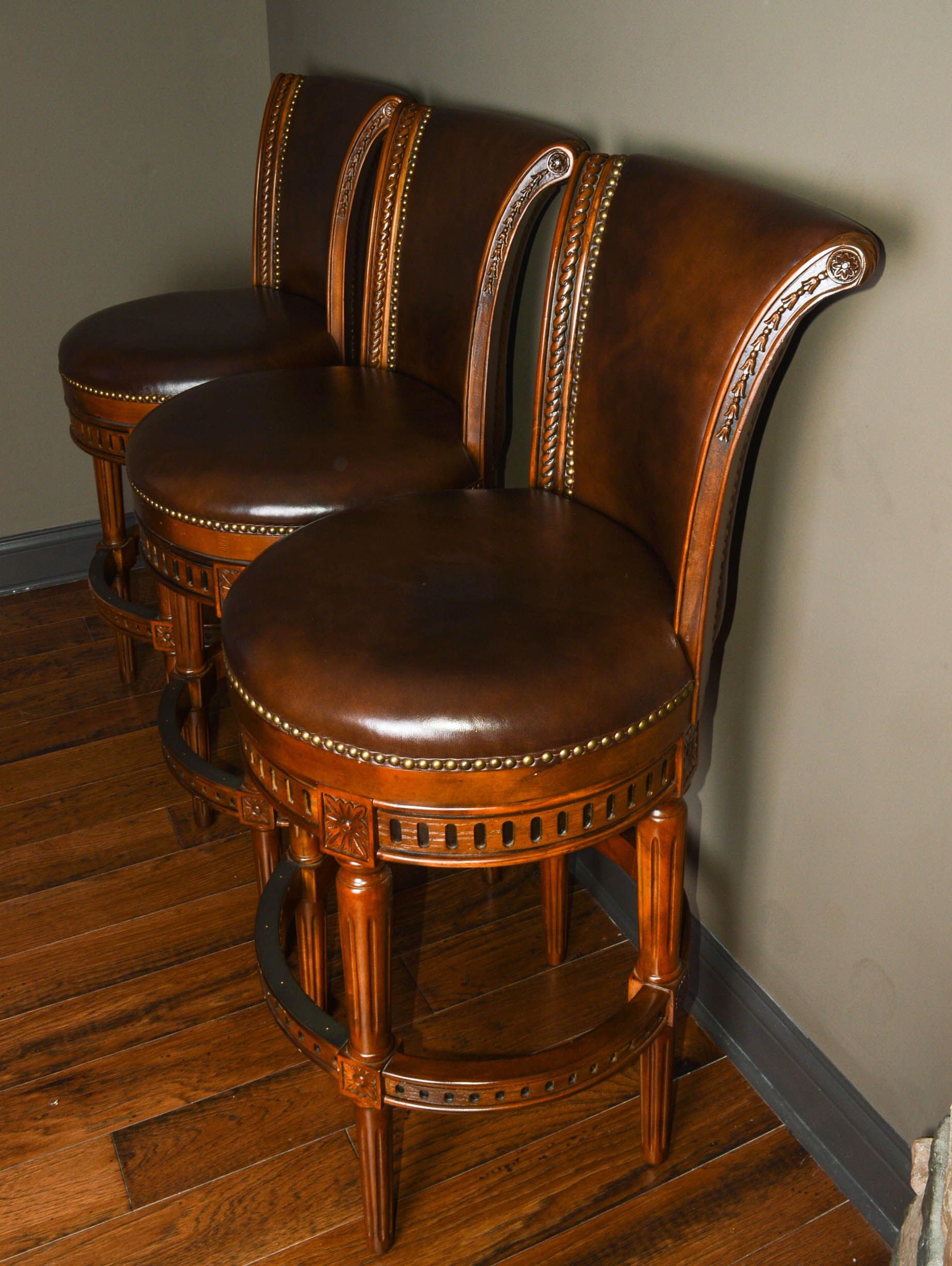 Three Frontgate Manchester Swivel Bar Stools Ebth