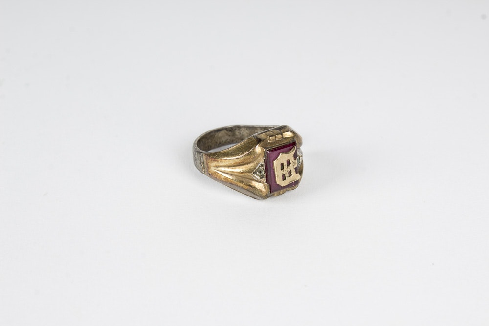 gold and sterling silver class ring with synthetic stones