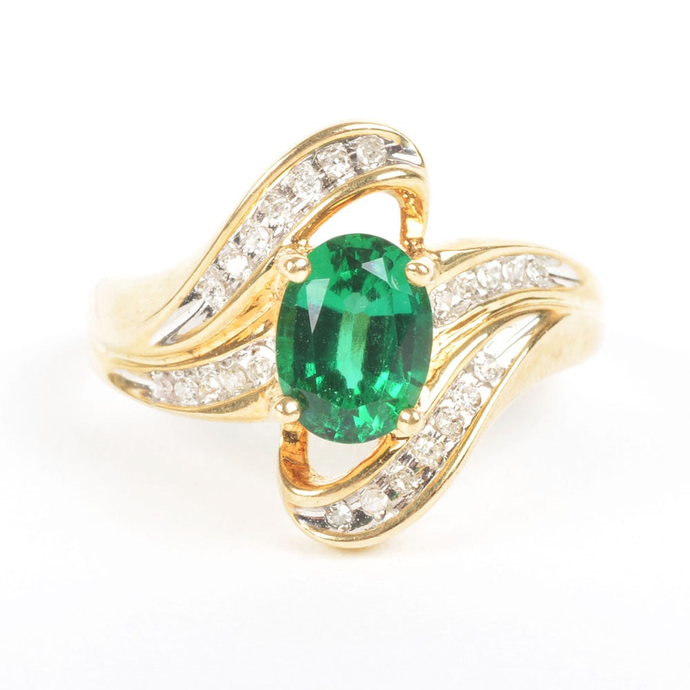 Emerald Yellow Gold Ring with Diamond Sweeps