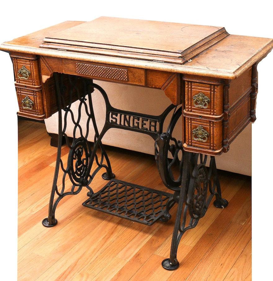 antique singer sewing machine with cabinet ebth. Black Bedroom Furniture Sets. Home Design Ideas