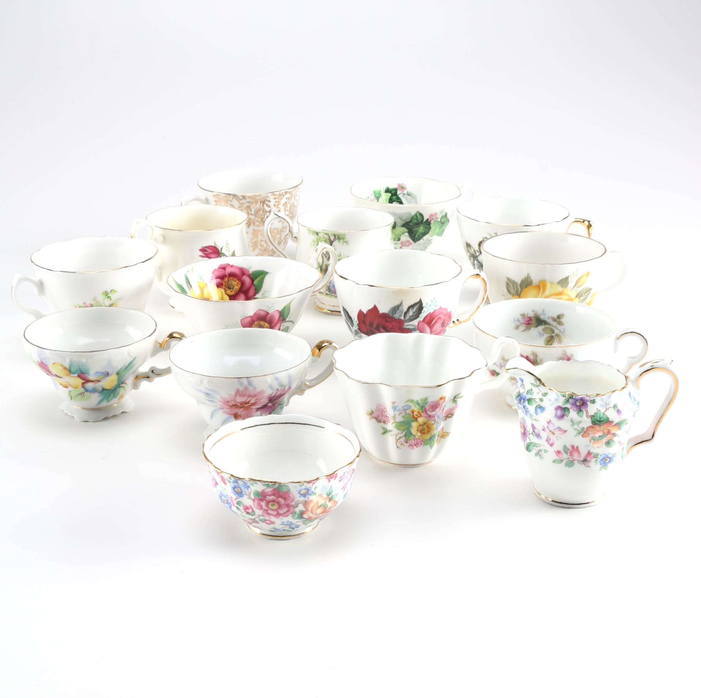 Assortment of China Teacups, Sugar Bowl and Creamer