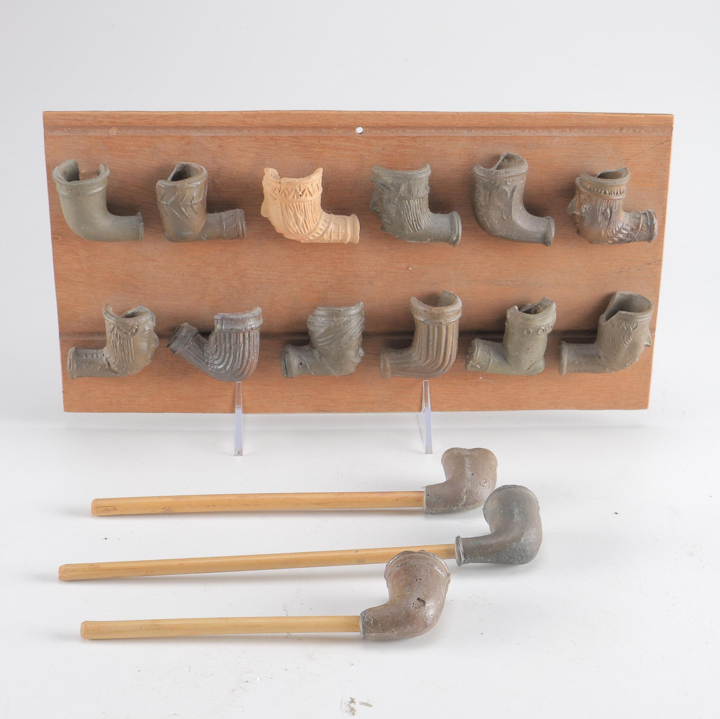 Clay Pipe Bowl Display With Pipes