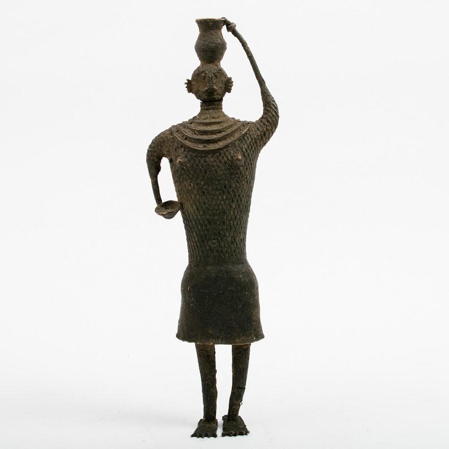 Primitive Cast Metal Statue