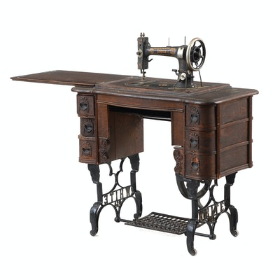 antique singer sewing machine table ebth. Black Bedroom Furniture Sets. Home Design Ideas