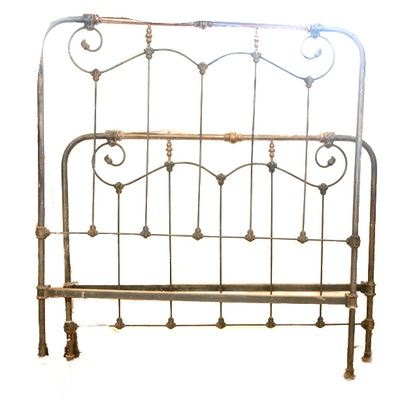 An Antique Brass Bed With Decorative Embossed Panels