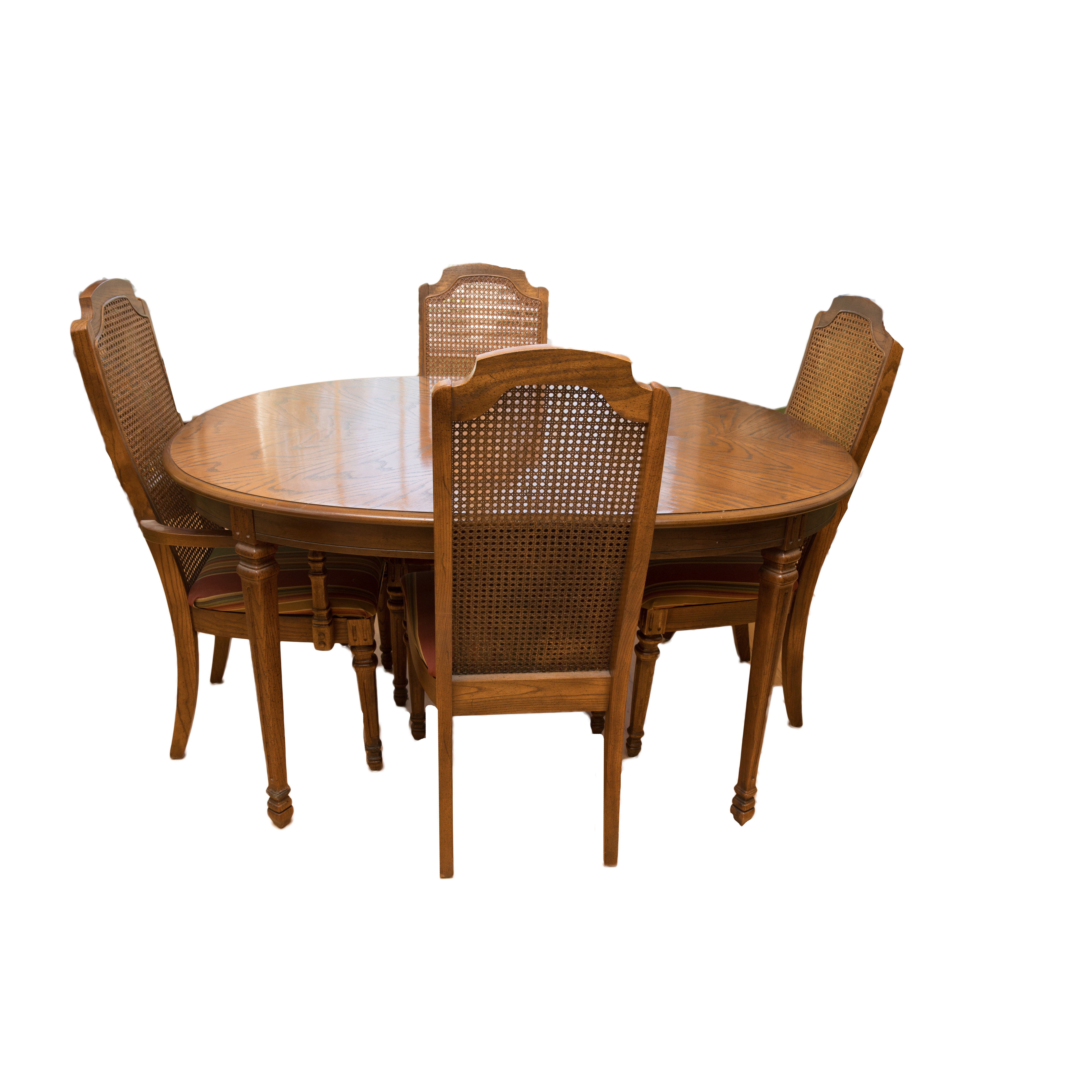 Oval Dining Room Table with Four Cane Back Chairs