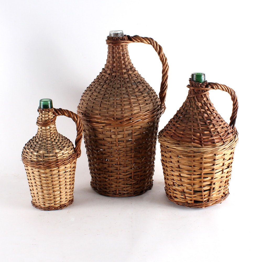 Vintage Three Green Glass Wine Jugs with Wicker Basket Covering