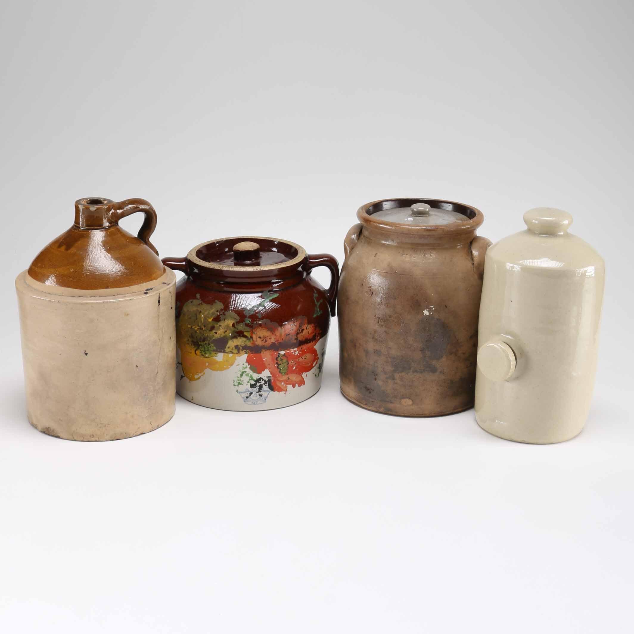 Group of Four Stoneware Jars