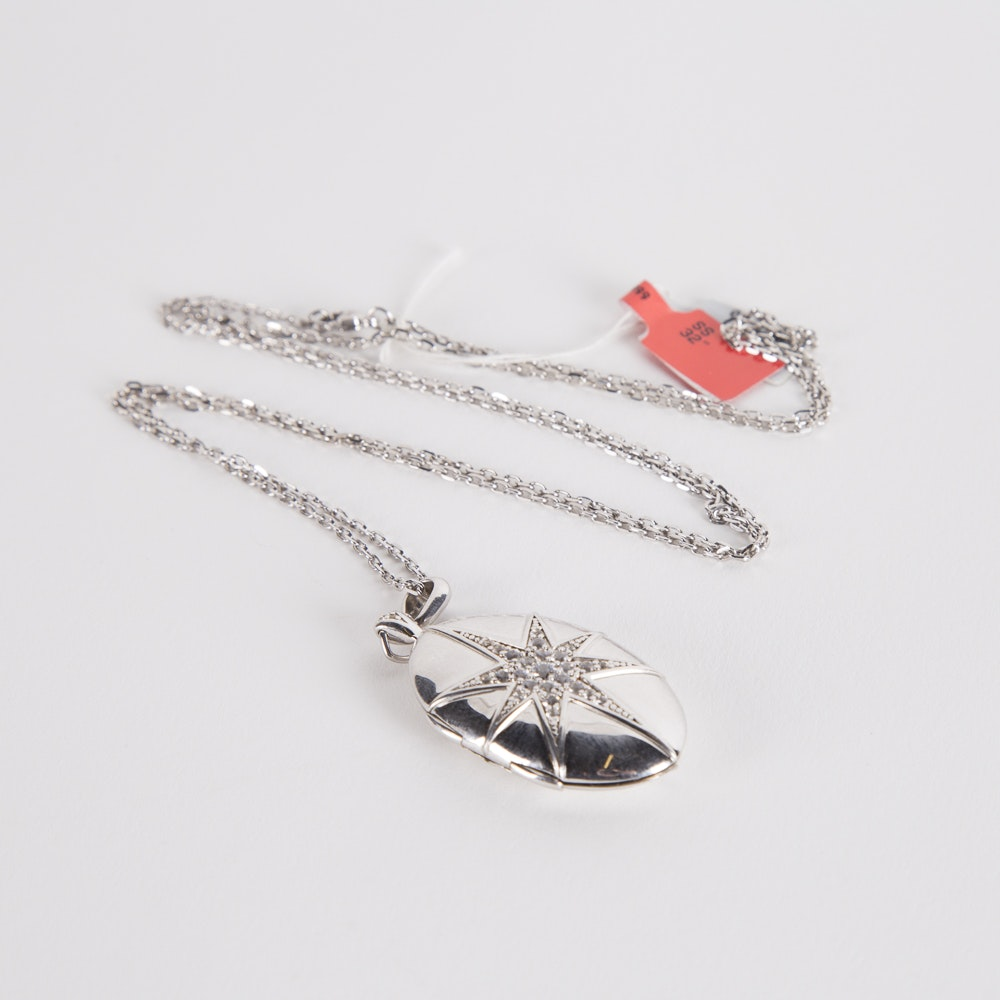Sterling Silver And Cubic Zirconia Starburst Locket on a Sterling Chain