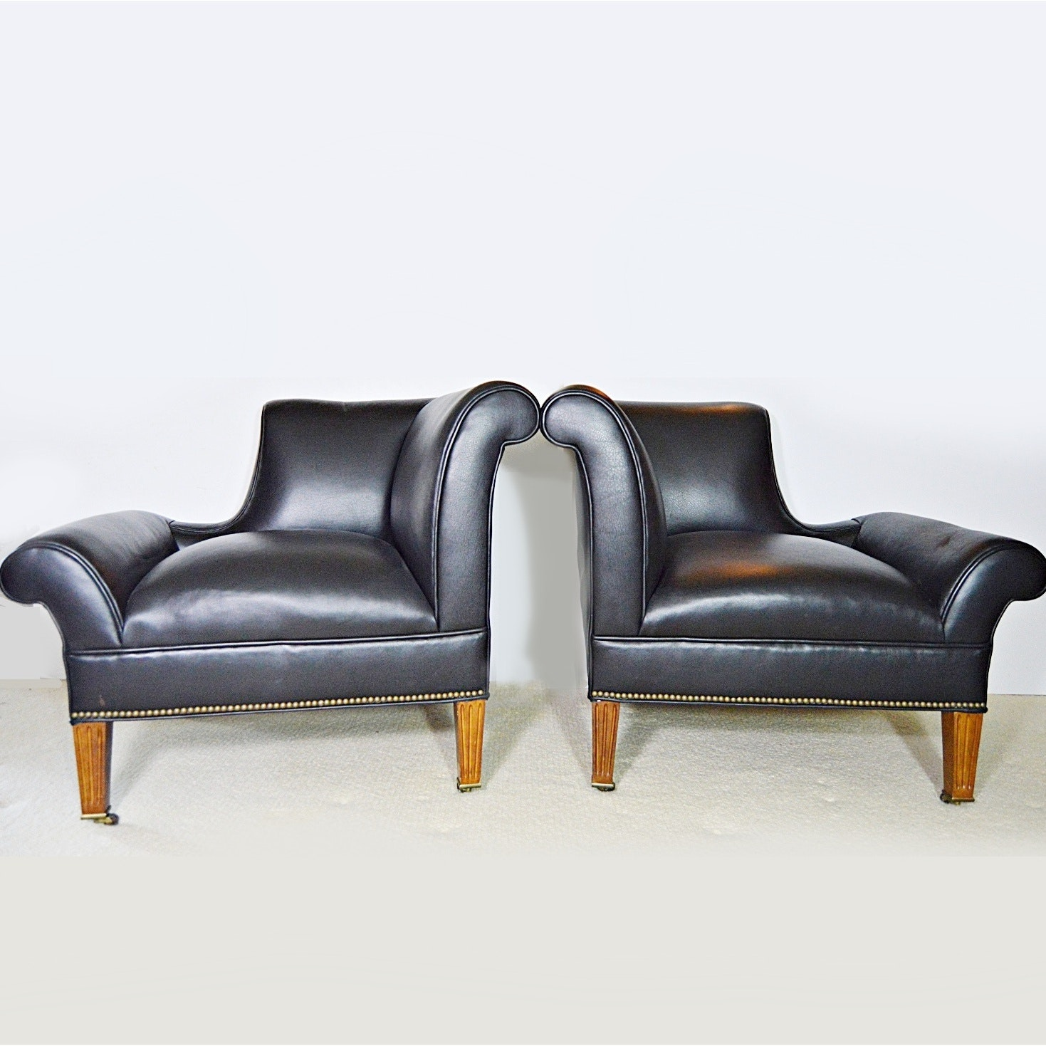Pair of Equestrian Right and Left Facing Armchairs