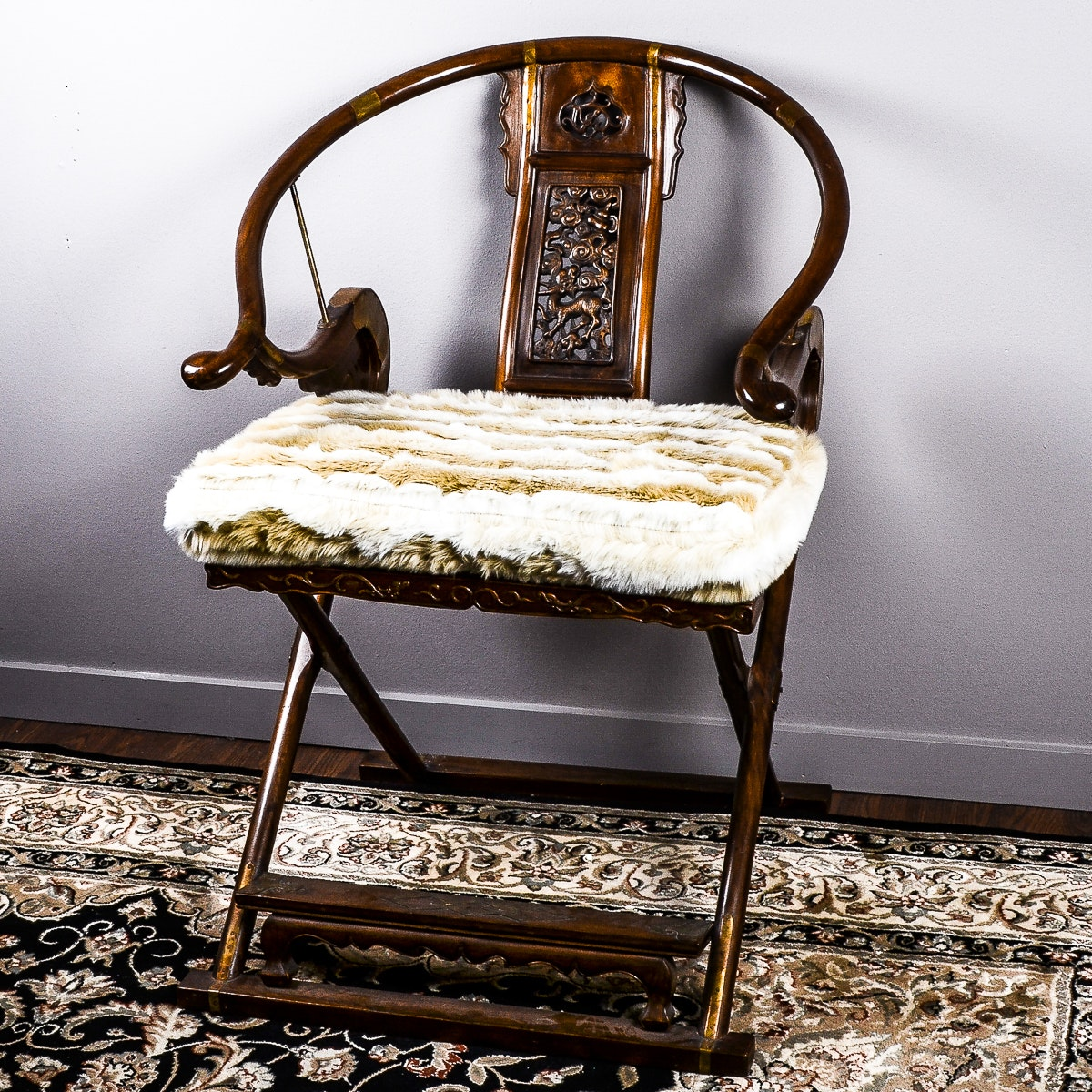 20th Century Chinese Carved Horseshoe-Back Folding Armchair