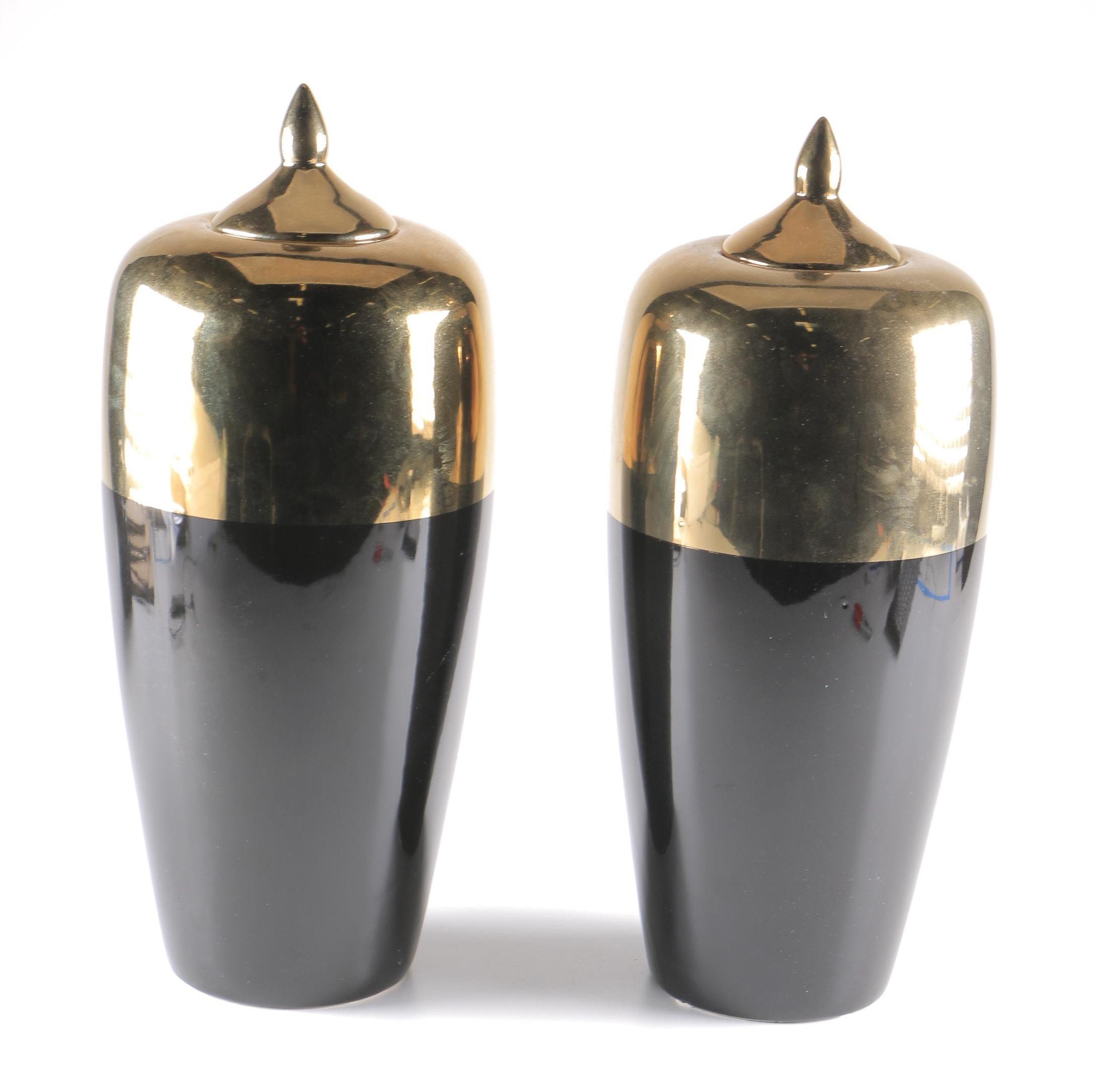 Two Black and Brass Decorative Urns